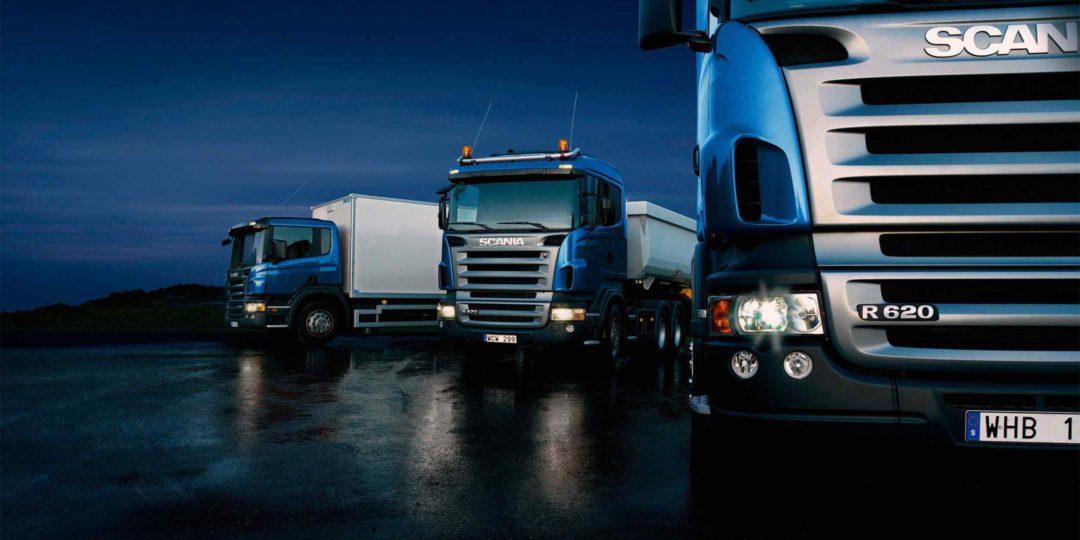 Three-trucks-on-blue-background-1080x540.jpg